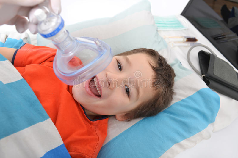 Little boy with an oxygen mask royalty free stock photography