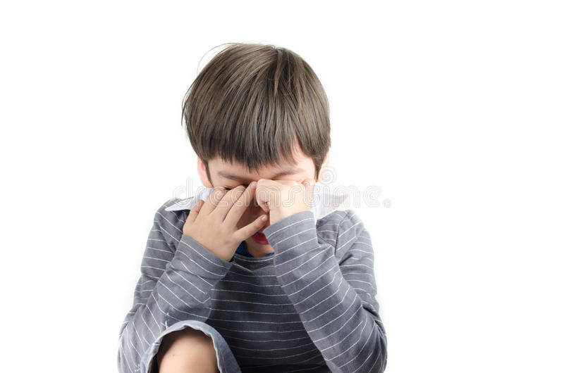 Little boy pain his eyes put finger isolayr on white backgroud royalty free stock images