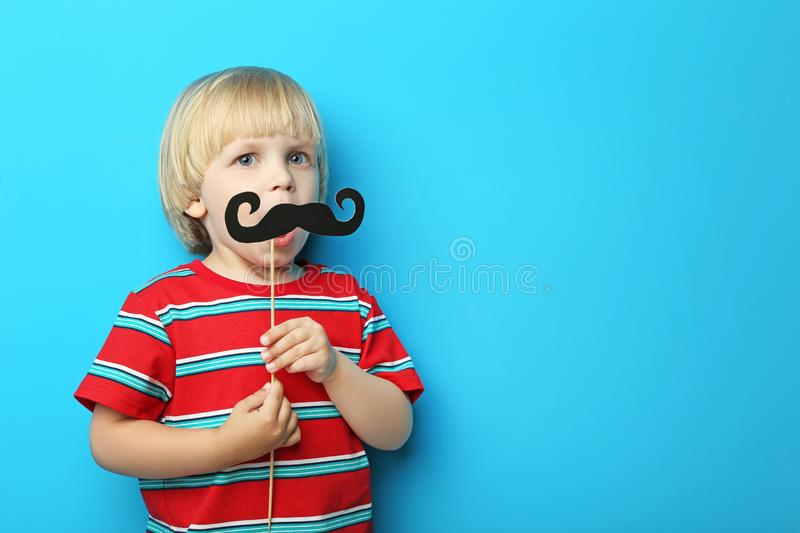 Little boy with paper mustache royalty free stock images