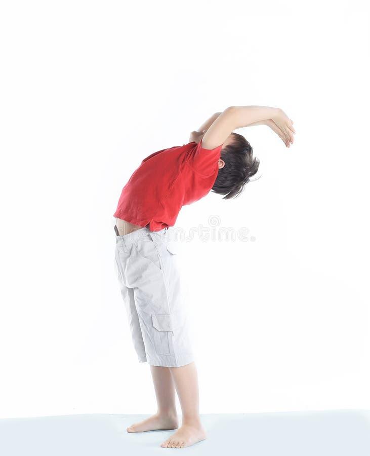 Little boy performs an exercise the bridge .isolated on white stock photos