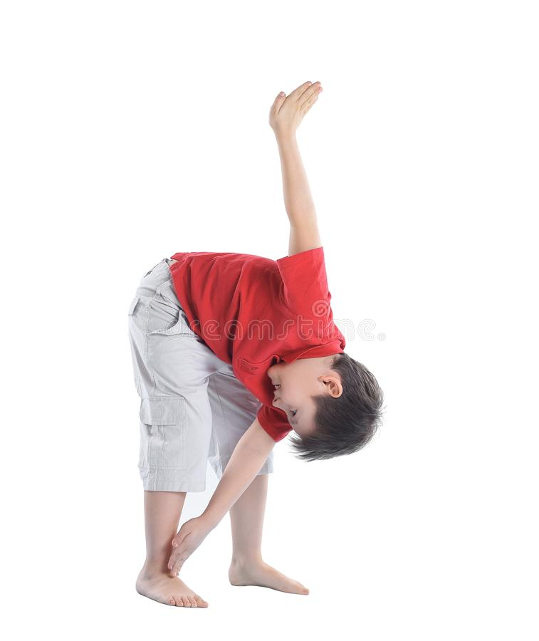Little boy performs an exercise to stretch the muscles.isolated on white stock image