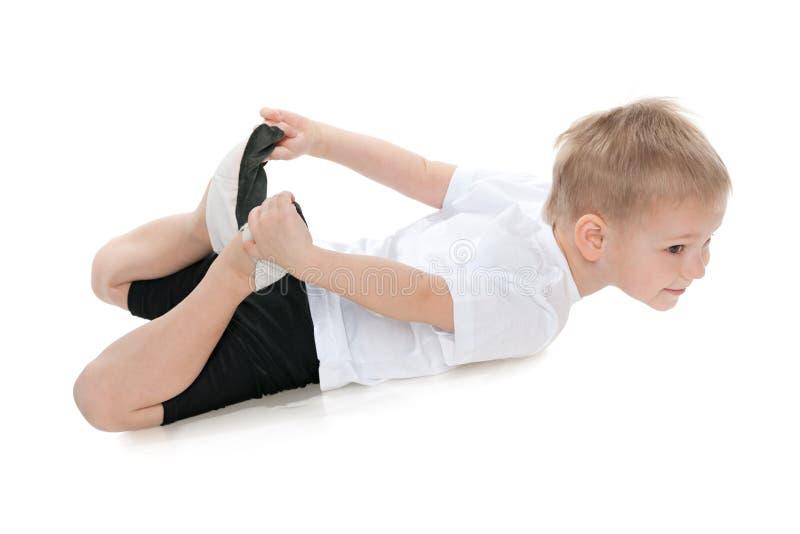 Little boy performs gymnastics royalty free stock photos
