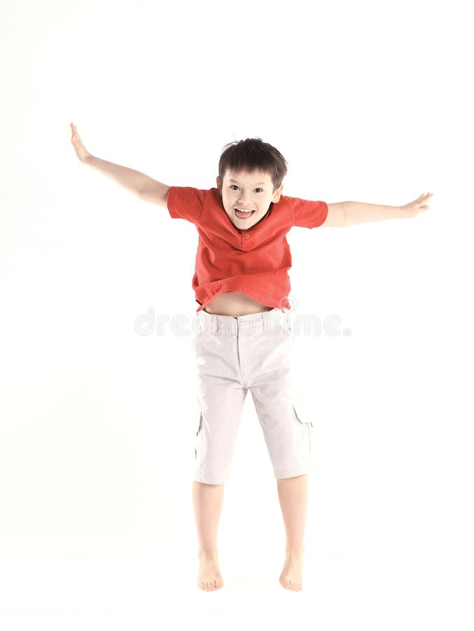 Little boy performs a jumping exercise.isolated on white royalty free stock photography