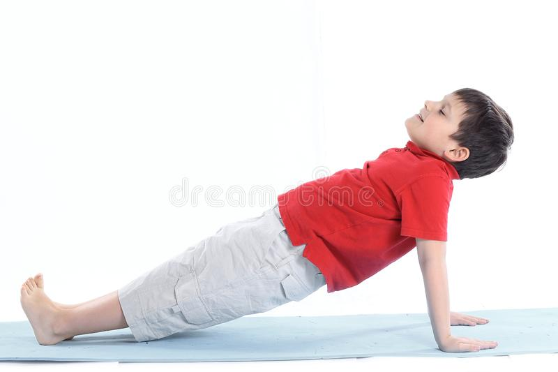 Little boy performs morning health gymnastics.isolated on white royalty free stock photos