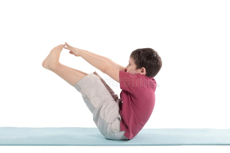 Little boy performs morning health gymnastics.isolated on white stock photography