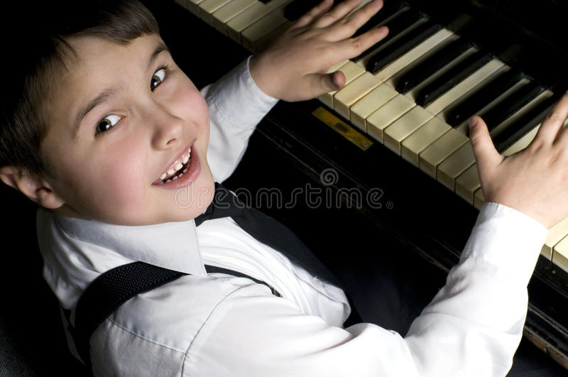 Little boy and piano. stock photo