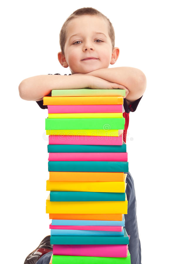 Little boy with pile of books royalty free stock photography