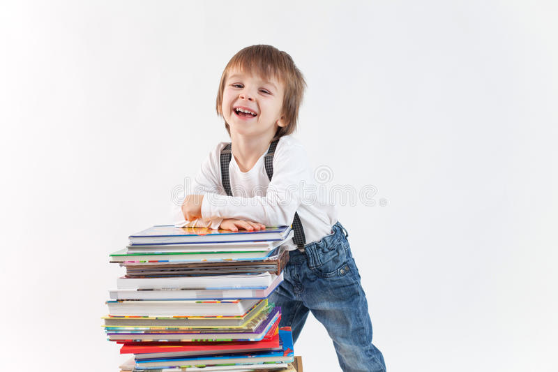Download Little Boy With A Pile Of Books Stock Photo - Image: 37078614