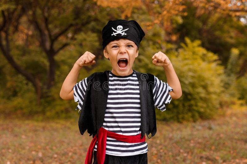 Little boy in pirate costume showing strength stock photography