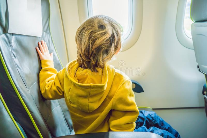 Little boy in the plane looking out the window royalty free stock photos
