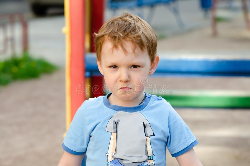 Little boy on the playground royalty free stock photos