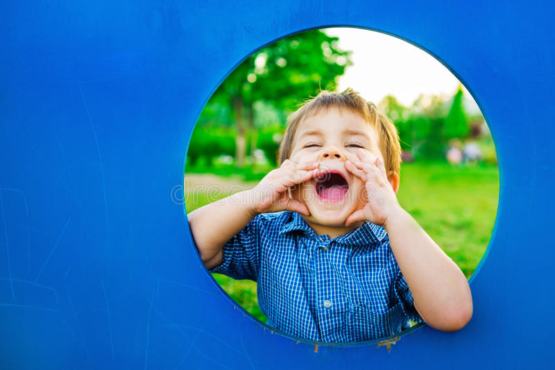 Little boy in playhouse royalty free stock photos