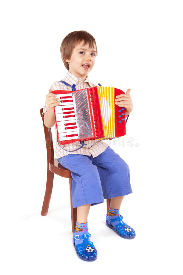 Little boy playing accordion royalty free stock photo