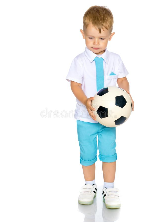 A little boy is playing with a ball. royalty free stock photo