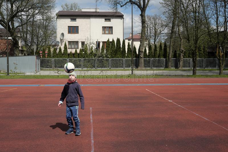 Little boy is playing ball stock photography