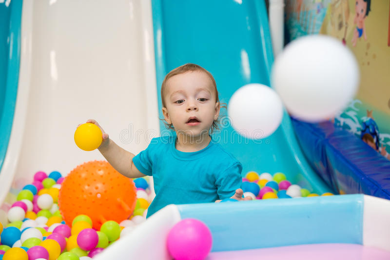 Little boy playing with balls. In the entertainment center stock photos