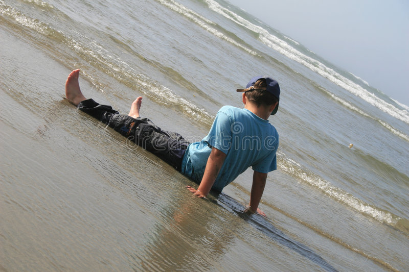 Download Little Boy Playing On Beach Stock Image - Image: 1060363