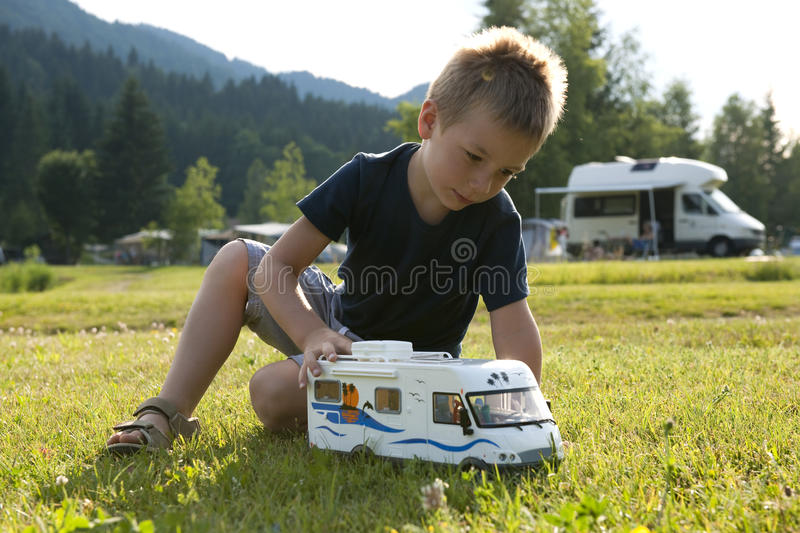 Download Little Boy Playing At Camping Site Stock Photo - Image: 15170178
