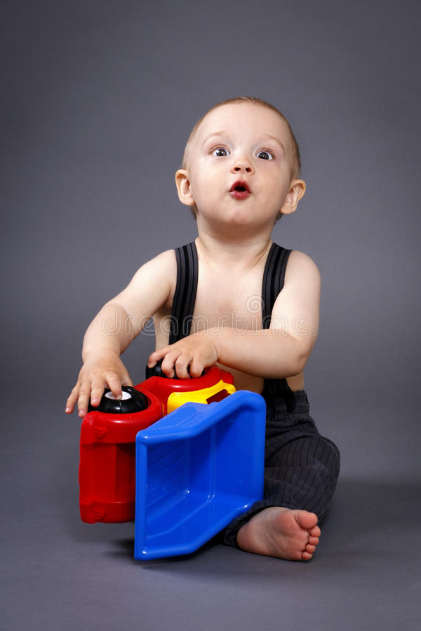 Little boy playing with car. Studio portrait royalty free stock photos