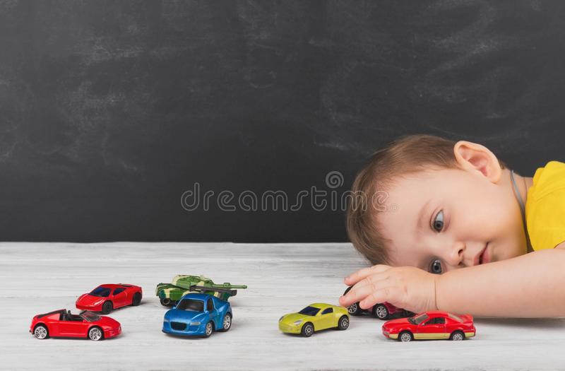 Little boy playing with cars at home. The concept of a carefree stock photos