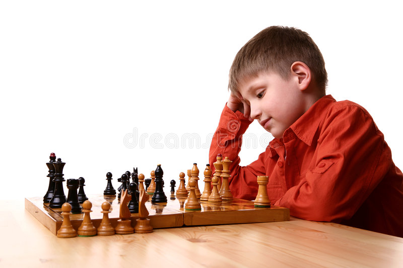 Little boy playing chess royalty free stock photos