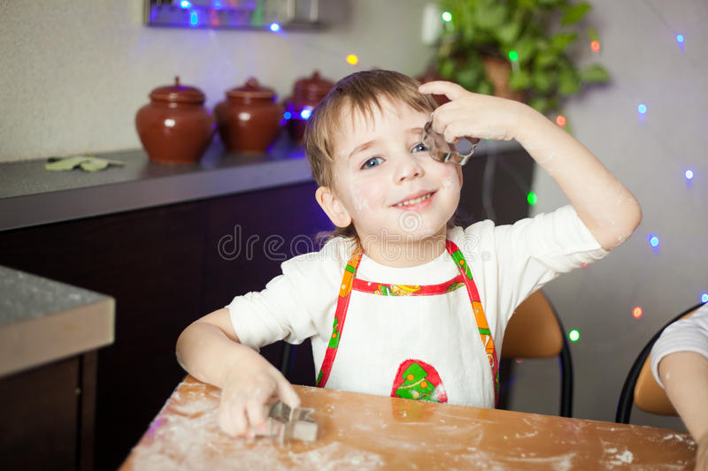 Little boy playing with cookie cutters royalty free stock photos