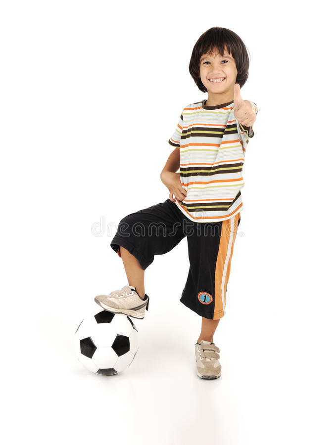 Little boy playing football isolated stock image