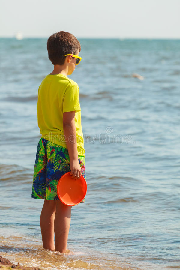 Little boy playing with frisbee disc. royalty free stock photography