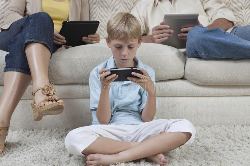 Download Little Boy Playing Games On PSP Stock Photo - Image: 29666458