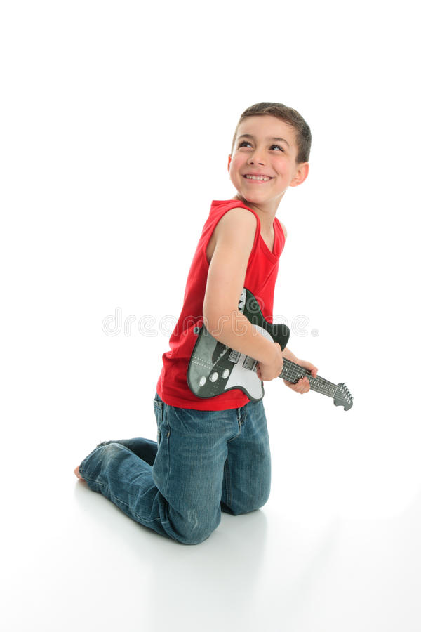 Download Little boy playing guitar stock image. Image of sound - 18096779