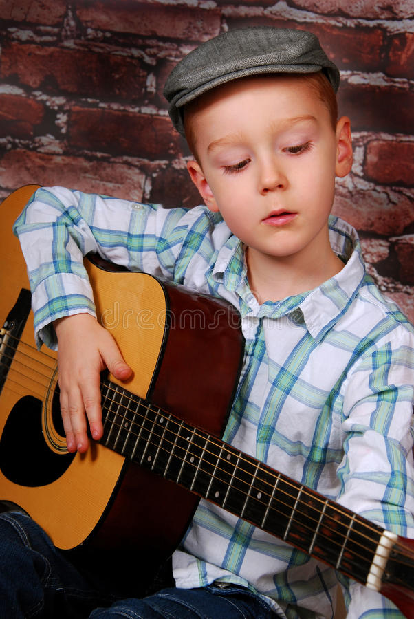 Download Little boy playing guitar stock image. Image of entertainment - 28384847
