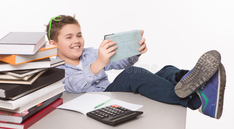 Little boy playing with his tablet PC stock photos