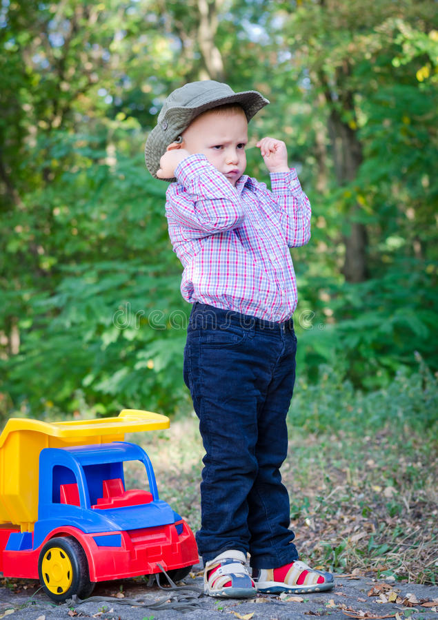 Download Little Boy Playing With His Toy Truck Stock Photo - Image: 26818450