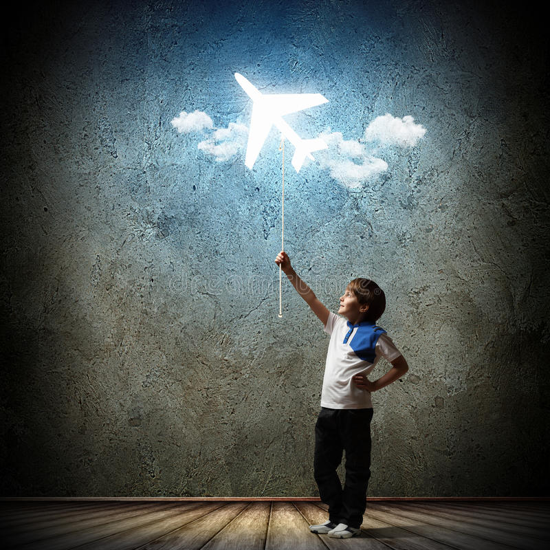 Little boy playing. Image of little cute boy playing with airplane balloon stock photos