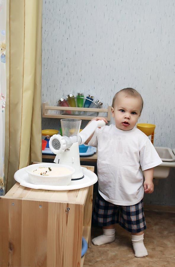 Little boy playing kitchen royalty free stock photo
