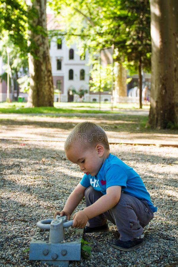 Little boy playing in nature stock image