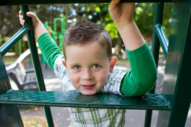 Little boy playing in the park royalty free stock photos