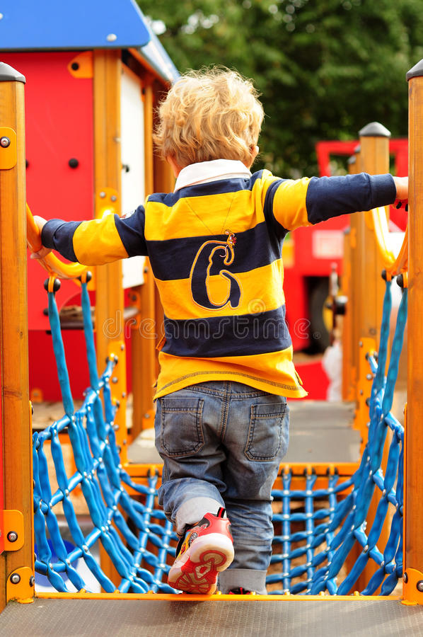Little boy playing at the park royalty free stock photos