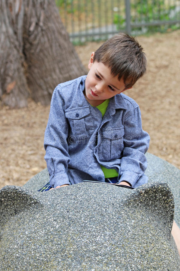 Little boy playing in the park stock photography