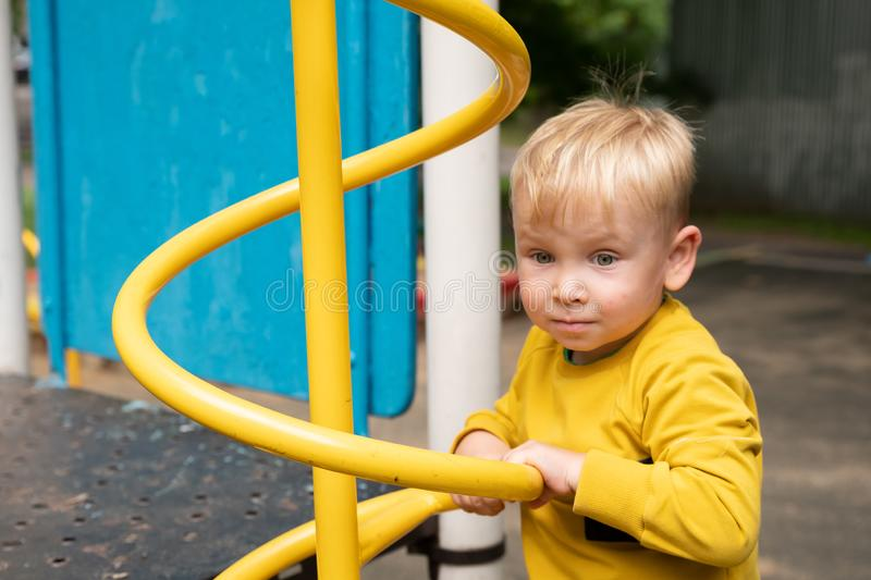 Little boy playing on the playground stock photography