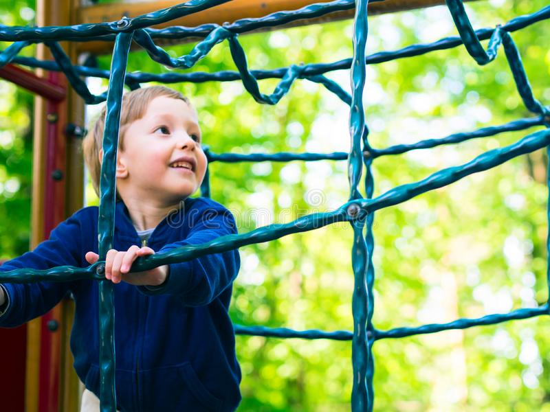 Little boy playing on a playground. Activity royalty free stock photos