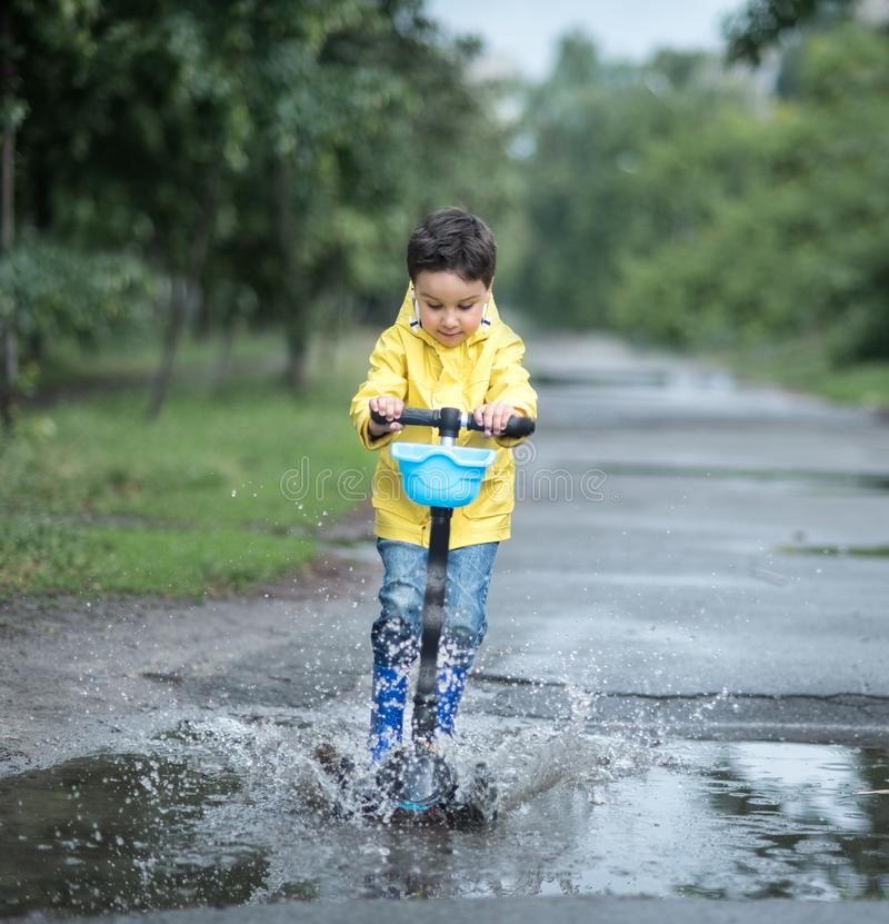 Little boy playing in puddle royalty free stock photos