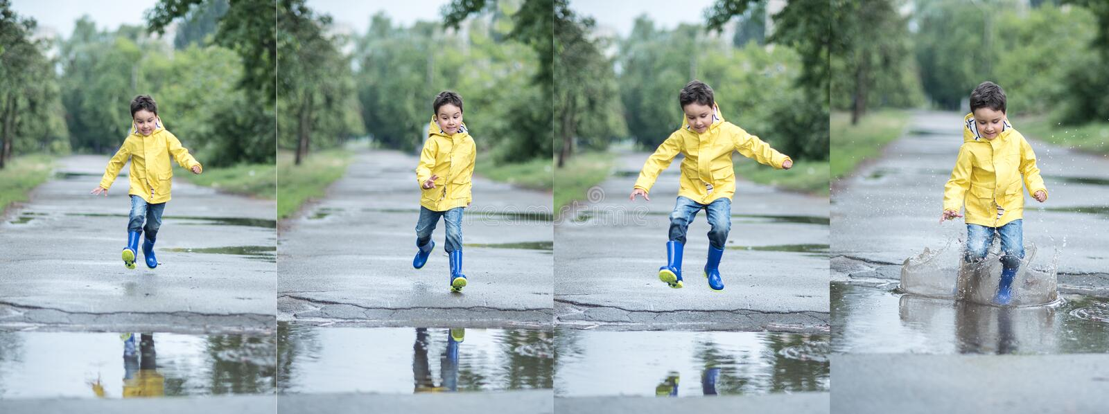 Little boy playing in puddle stock image