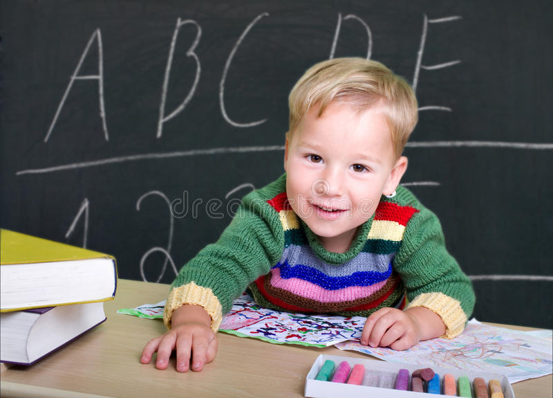 Little boy playing school royalty free stock images