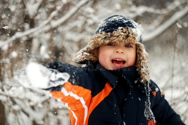 Little Boy Playing In The Snow royalty free stock image