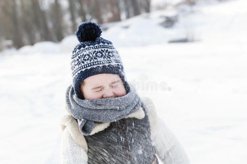 Little boy playing with snow in winter. royalty free stock photo