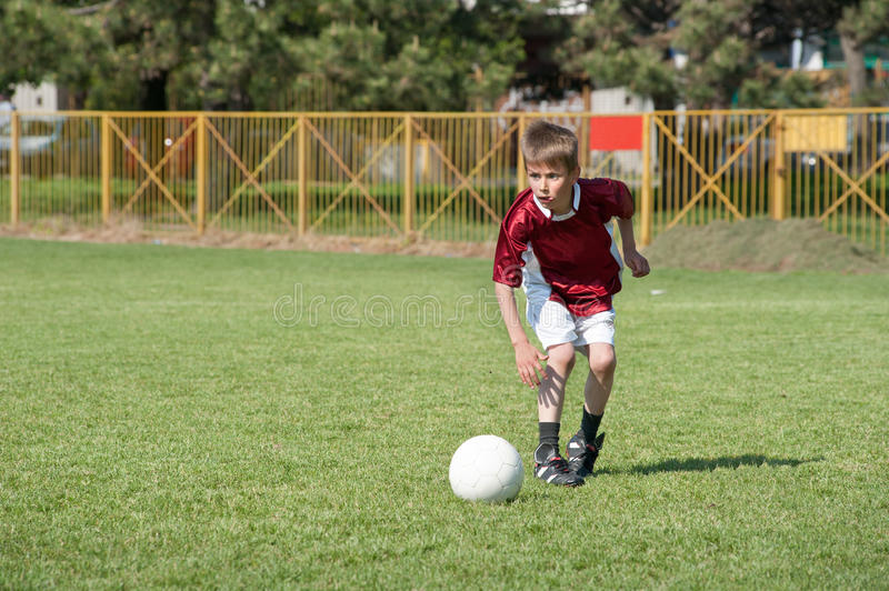Little Boy playing soccer stock image