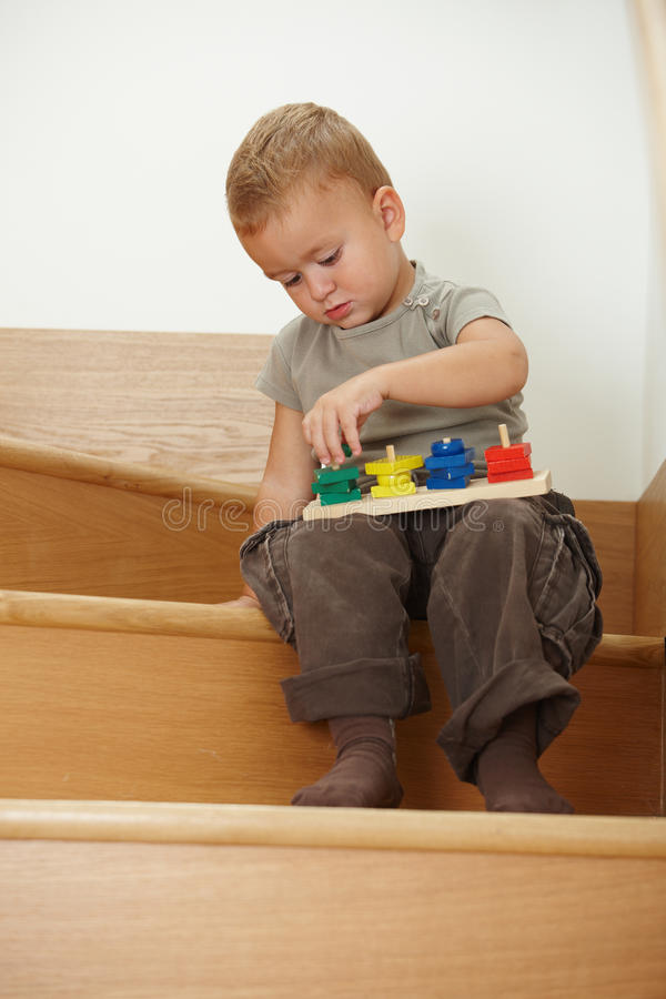 Download Little Boy Playing On Stairs Stock Image - Image of innocence, carefree: 12557659