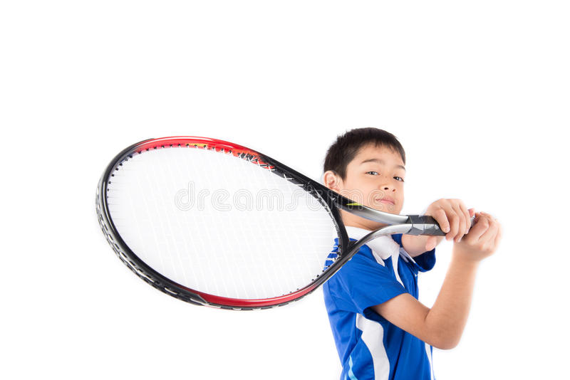 Little boy playing tennis racket and tennis ball in hand stock image