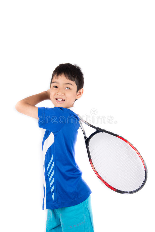 Little boy playing tennis racket and tennis ball in hand royalty free stock images